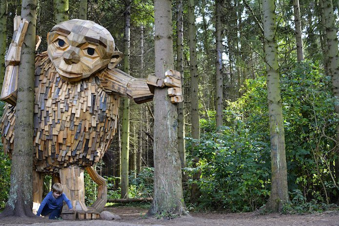He hides wooden giants in the forests all around Copenhagen